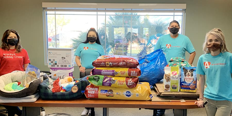 team with pet food donations